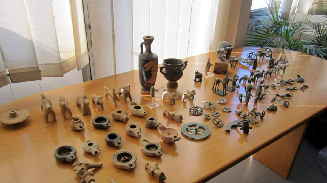 Ancient artefacts are seen on display in this photograph distributed by the Greek police after the arrest of three people who had stolen them from a museum in Ancient Olympia