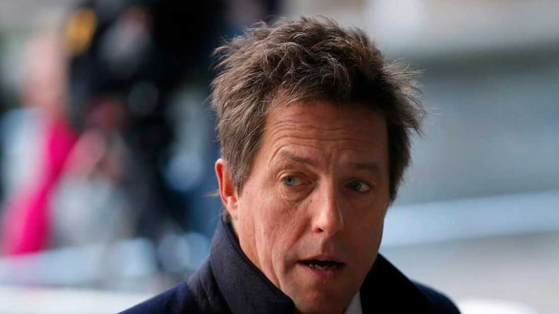 Hugh Grant arriving to read the Leveson report