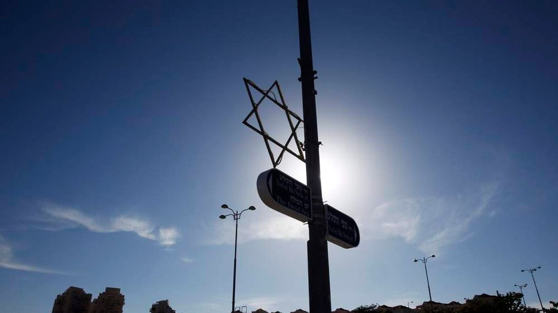 Star of David decorates a lamp post in a West Bank Jewish settlement near Jerusalem