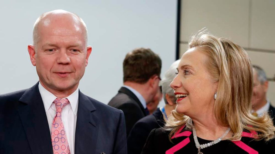 U.S. Secretary of State Clinton talks with British Foreign Secretary Hague at North Atlantic Council meeting at NATO headquarters in Brussels