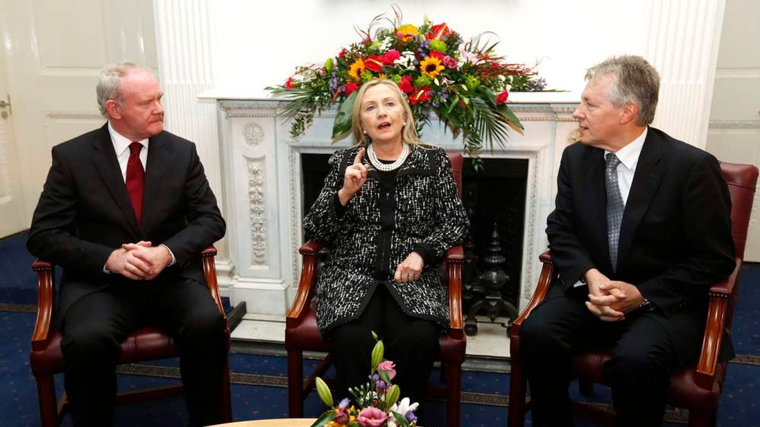 U.S. Secretary of  State Hillary Clinton gestures as she meets with Northern Ireland's First Minister Peter Robinson and Deputy First Minister Martin McGuinness in Belfast