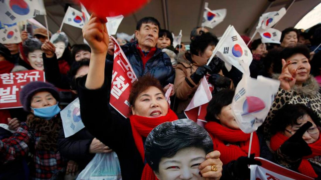 Supporters of South Korea's ruling Saenuri Party's presidential candidate Park react during her election campaign rally in Siheung