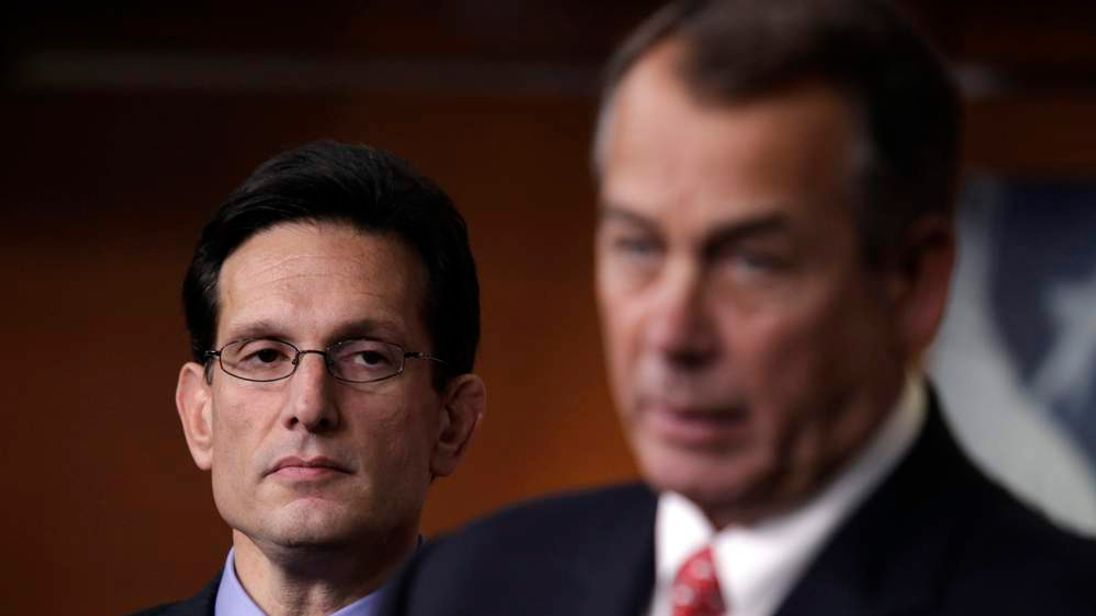 """U.S. House Majority Leader Cantor looks on as House Speaker Boehner speaks to the media on the """"fiscal cliff"""" in Washington"""