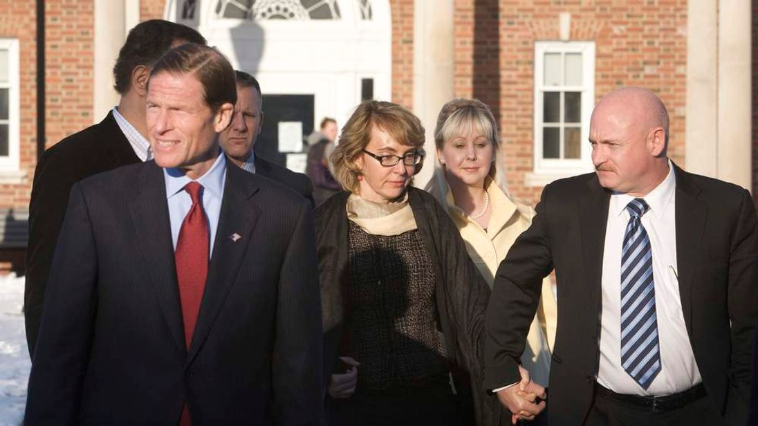 U.S. Senator Blumenthal, former U.S. Representative Giffords and her husband, former astronaut Kelly, leave the Newtown Municipal Building in Newtown,