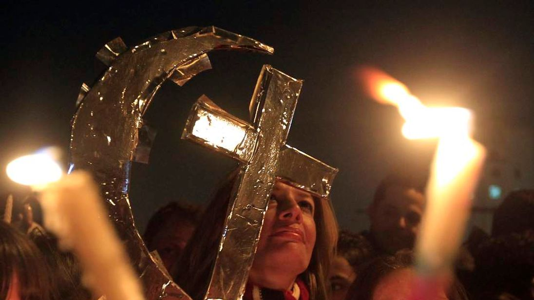 Egyptian Muslims and Christians celebrate Coptic Christmas eve mass, at Tahrir Square in Cairo