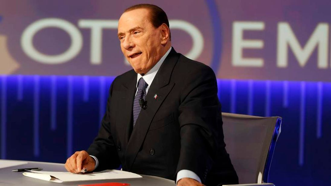 "Former Italian Prime Minister Silvio Berlusconi sits before the taping of the talk show ""Otto e mezzo"" (Eight and a half) at La7 television in Rome"