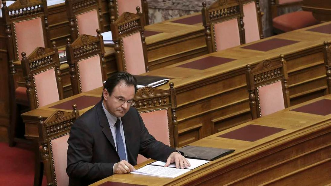 Greece's former Finance minister George Papaconstantinou attends a parliament session in Athens