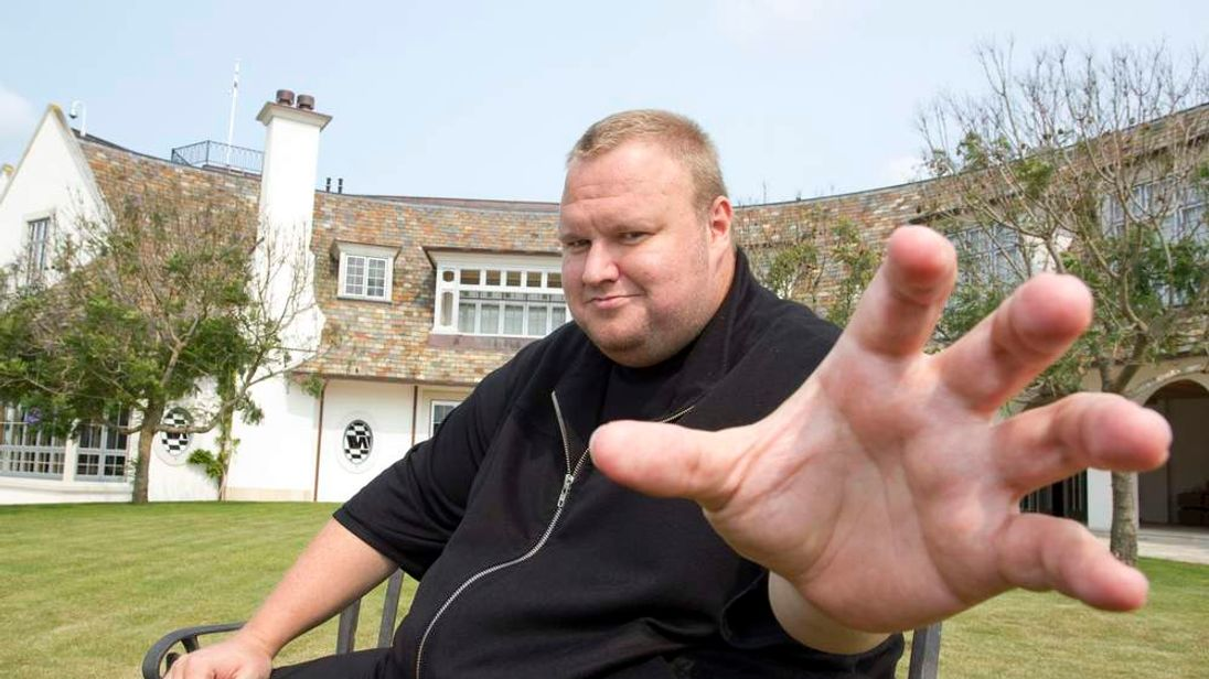 Kim Dotcom gestures towards a camera after an interview with Reuters in Auckland