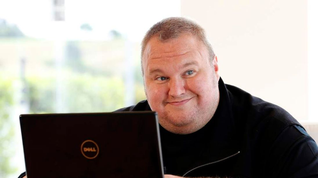 Kim Dotcom smiles during an interview with Reuters in Auckland