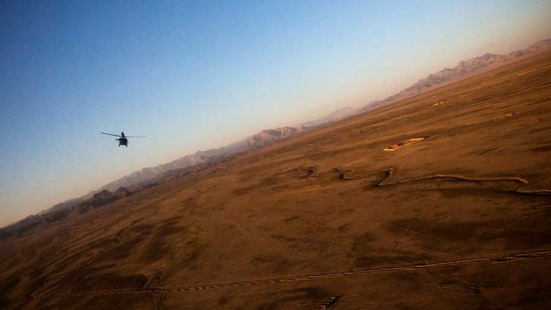 A U.S. Army Blackhawk helicopter flies above Kandahar Province