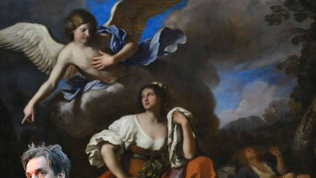 Penny, Director of the National Gallery, speaks in front of 'The Angel appears to Hagal and Ishmael' painted by Guercino circa 1652, at the National Gallery in London