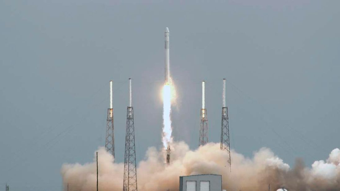 The SpaceX Falcon 9 rocket with the Dragon capsule, lifts off from the Cape Canveral Air Force Station on a second resupply mission to the International Space Station in Cape Canaveral