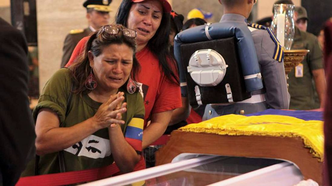 Supporters of late Venezuelan President Chavez react as they view coffin during wake at military academy in Caracas