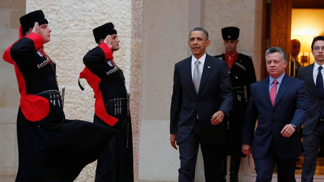 U.S. President Barack Obama is welcomed by Jordan's King Abdullah II during a ceremony at Al Hummar Palace in Amman