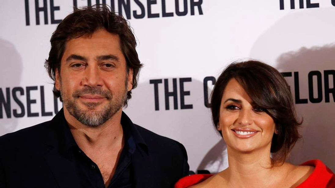 "Actors Javier Bardem and Penelope Cruz pose for photographers at a photocall for the film ""The Counselor"" in London"