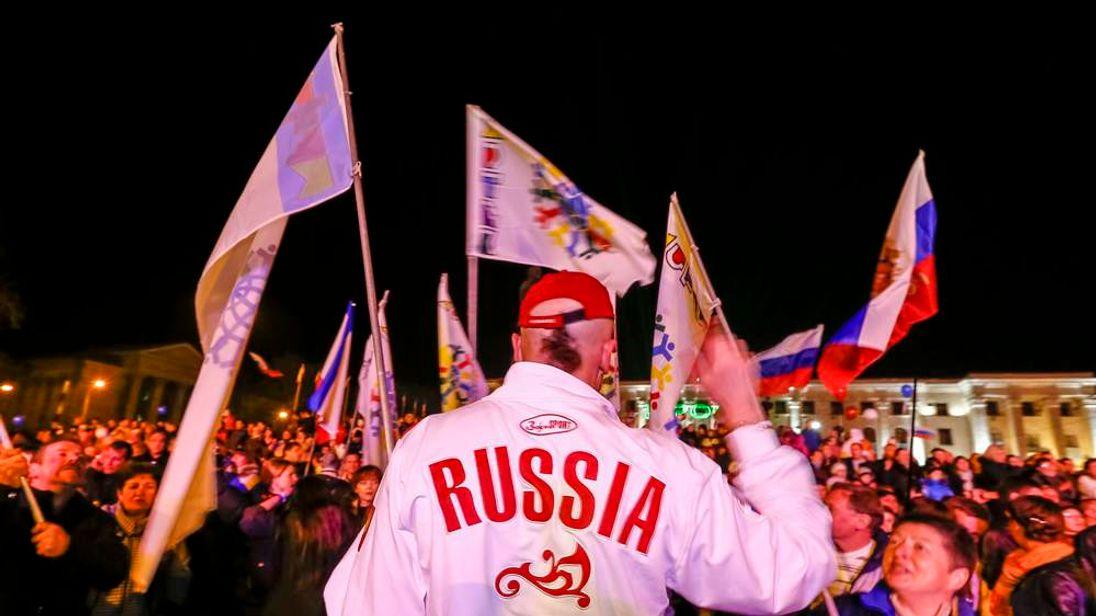 People celebrate on the main square in Simferopol
