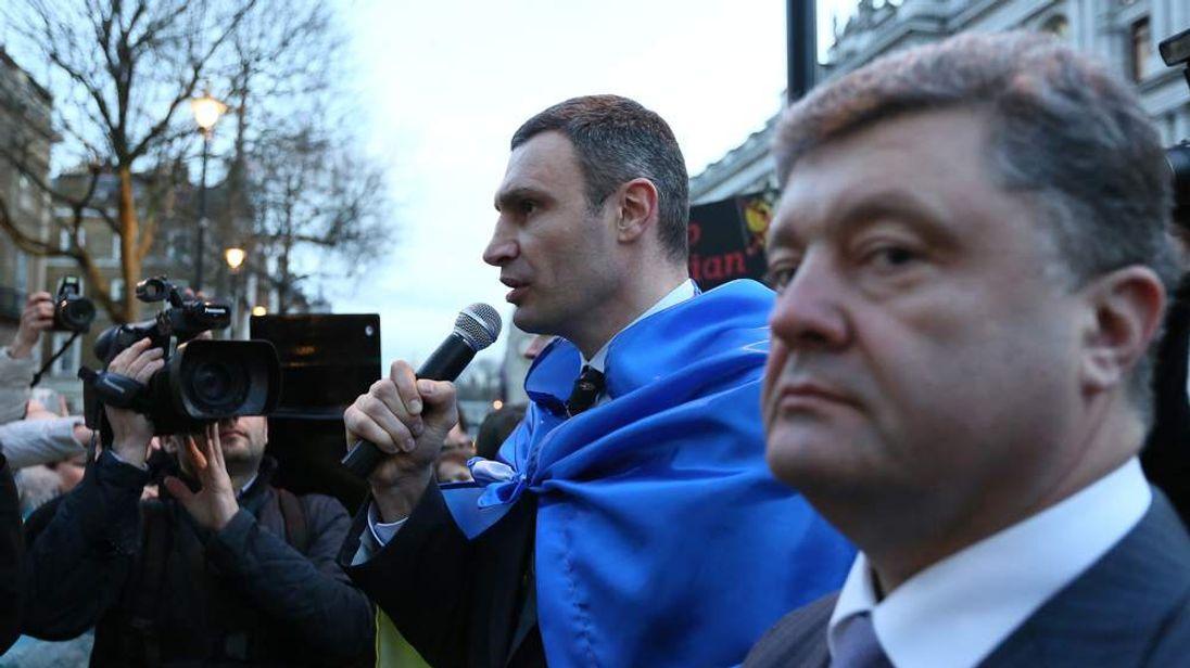 UDAR party leader Vitaly Klitschko speaks to supporters as Ukrainian MP Petro Poroshenko listens outside Downing Street in London