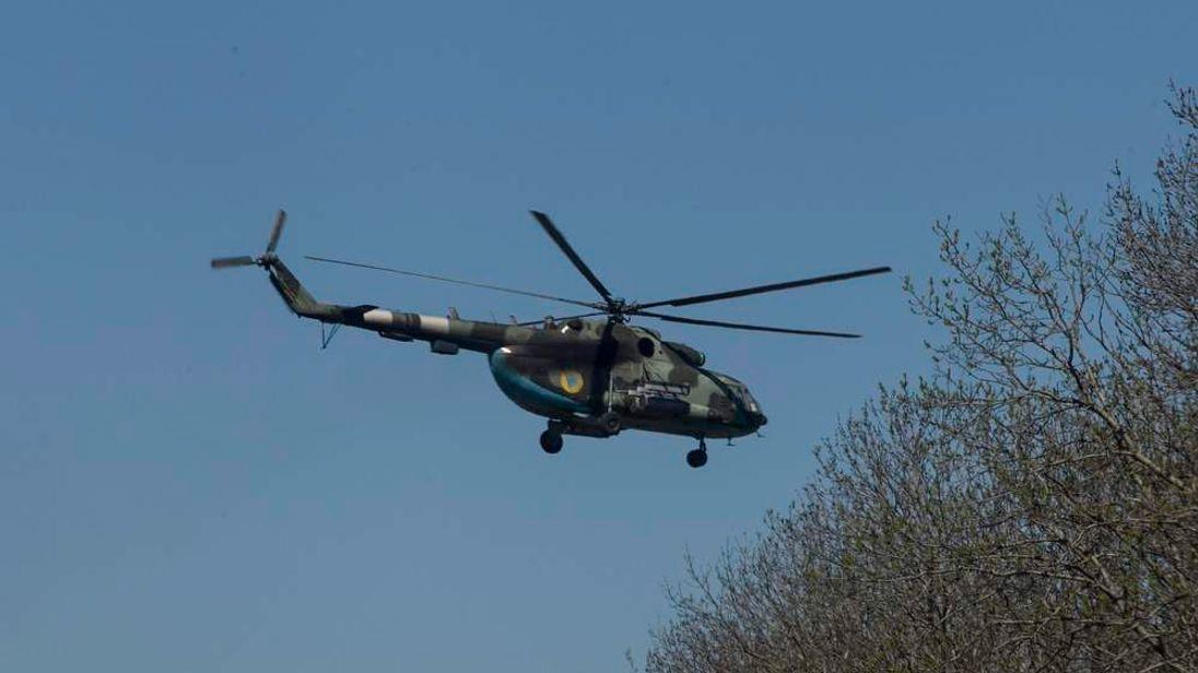 Ukrainian military helicopter flies near the village of Malinivka, east of Slaviansk in eastern Ukraine