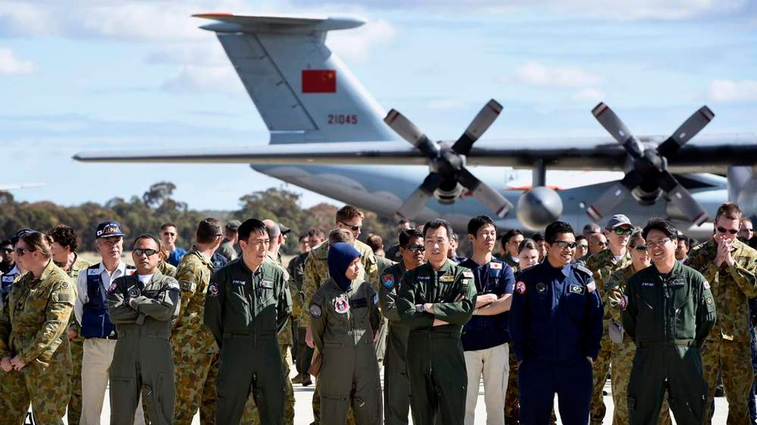 International and Australian aircrews involved in the search for missing Malaysia Airlines plane MH370 prepare for an official photograph in Bullsbrook