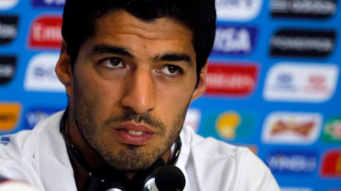 Uruguay's national soccer team player Luis Suarez attends a news conference
