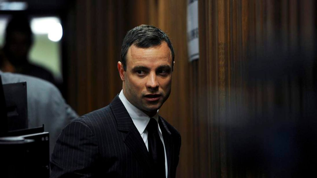 South African Olympic and Paralympic sprinter Oscar Pistorius arrives in court for his trial in Pretoria.