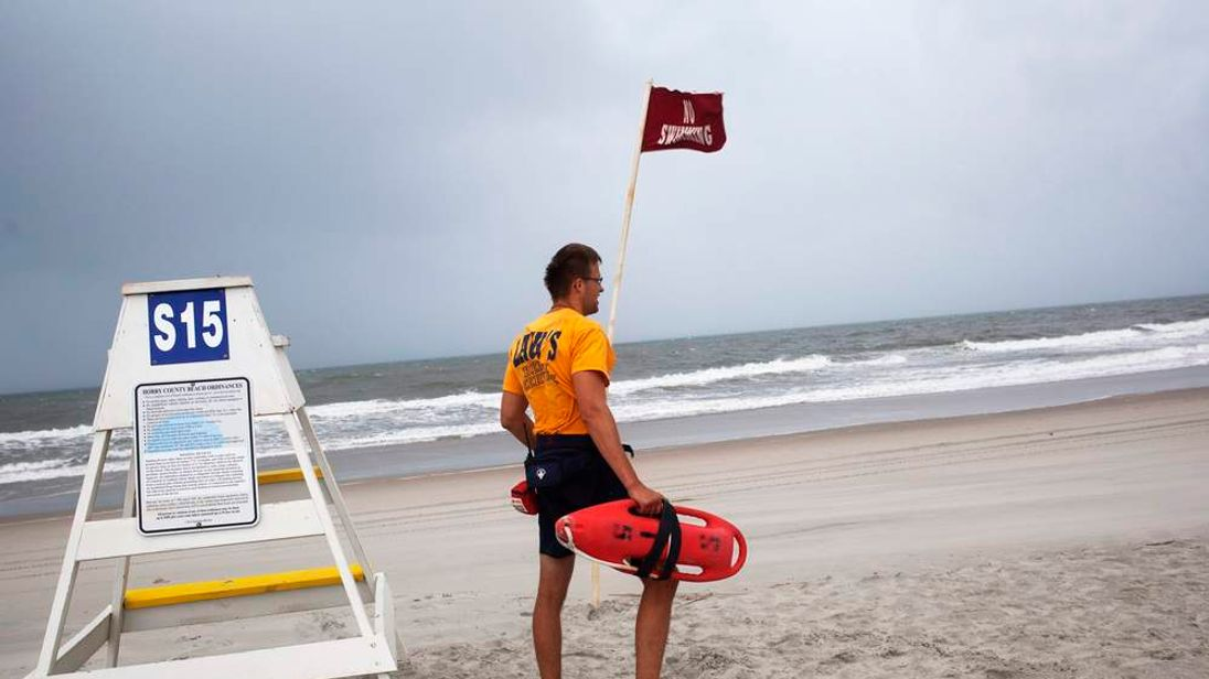 Michal Kubo, a lifeguard with Lack's Beach Service, prepares his lifeguard station at Myrtle Beach State Park in preparation for the arrival of Hurricane Arthur