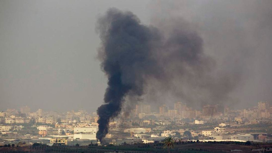 Smoke rises after an Israeli tank shelling in the northern Gaza Strip