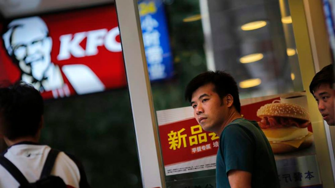 Customer walks out of a KFC store in downtown Shanghai