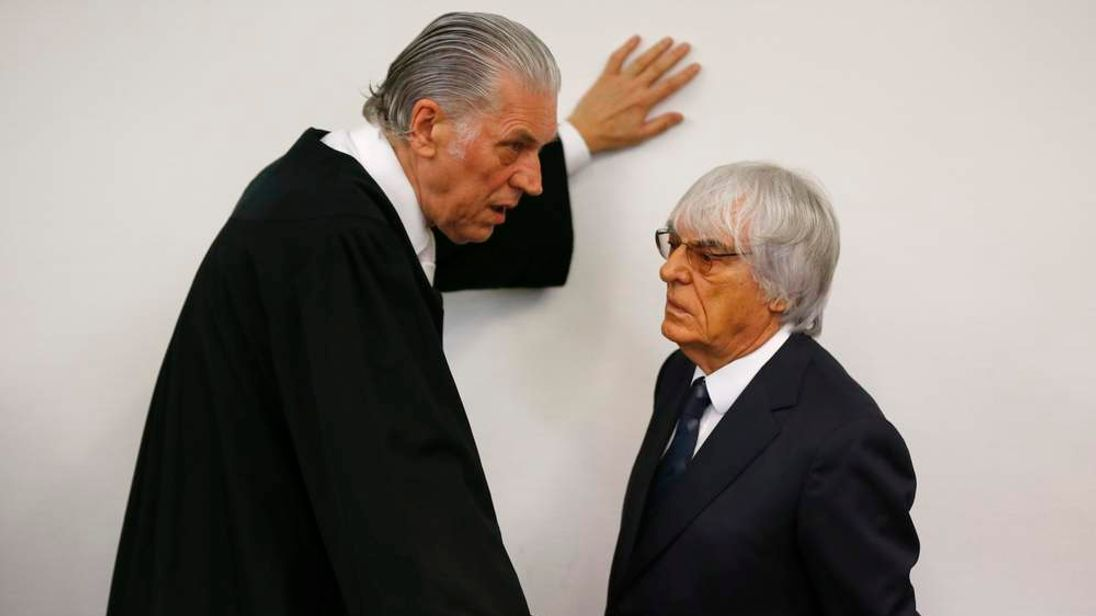 Bernie Ecclestone talks to his lawyer Sven Thomas (left)