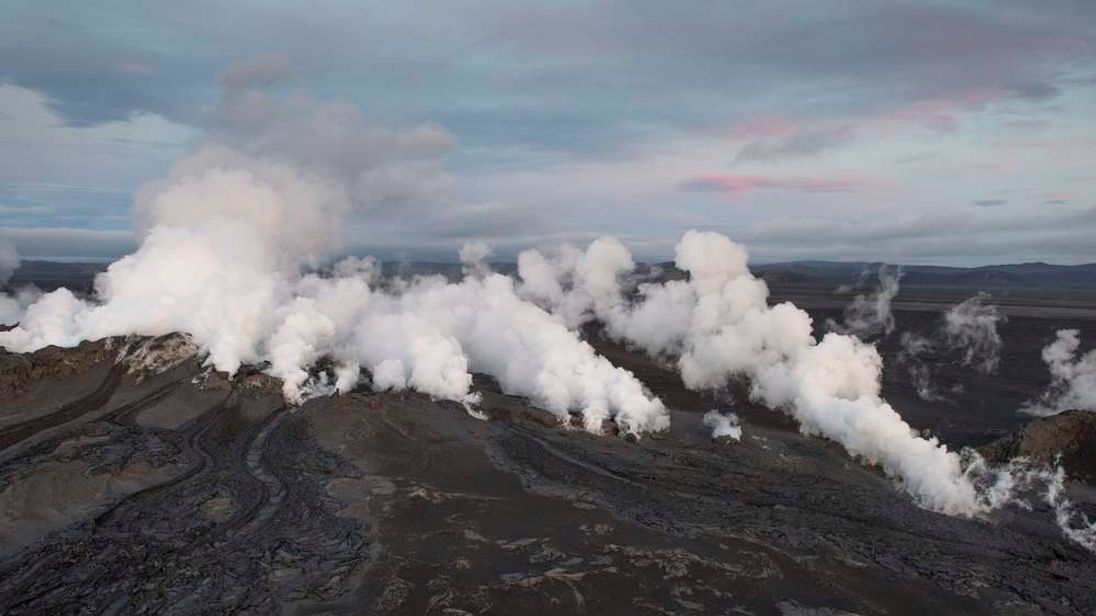 Steam and smoke rise over a 1-km-long fissure in a lava field north of the Vatnajokull glacier, which covers part of Bardarbunga volcano system