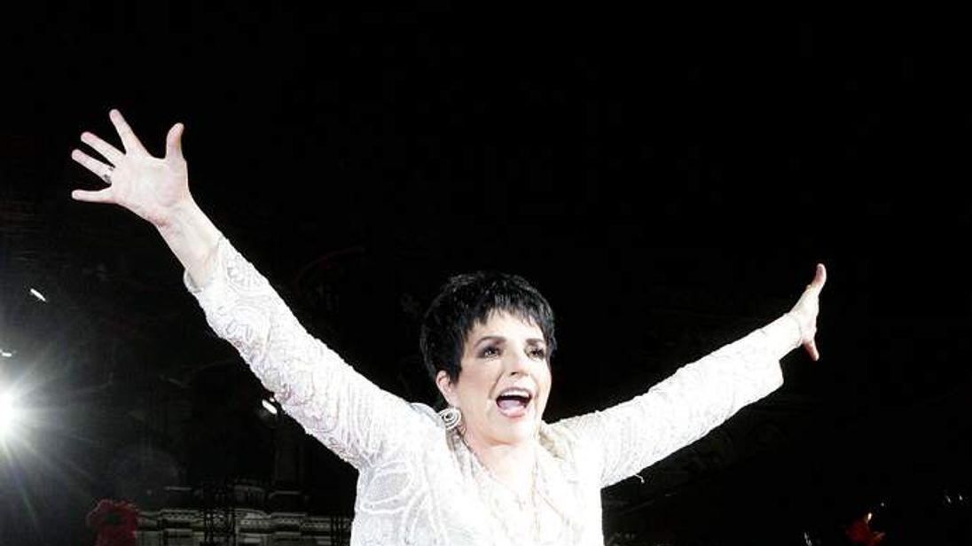 Liza Minelli arrives on stage at the annual Life Ball in Vienna.