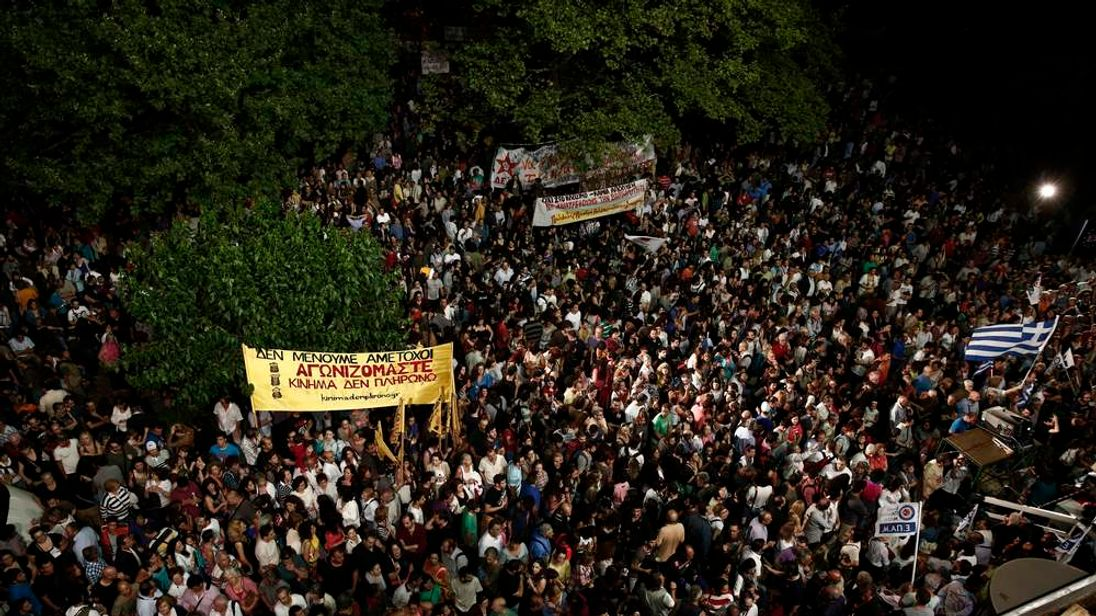 Protesters gather outside Greek state broadcaster ERT headquarters in Athens