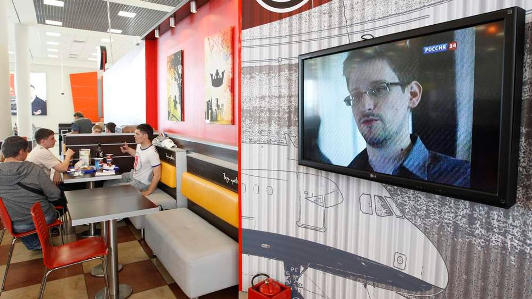 A television screen shows former US spy agency contractor Snowden during a news bulletin at a cafe at Moscow's Sheremetyevo airport