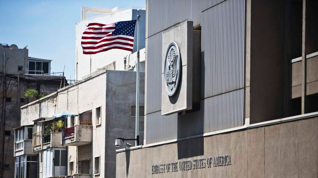 A flag flutters outside the U.S. embassy in Tel Aviv