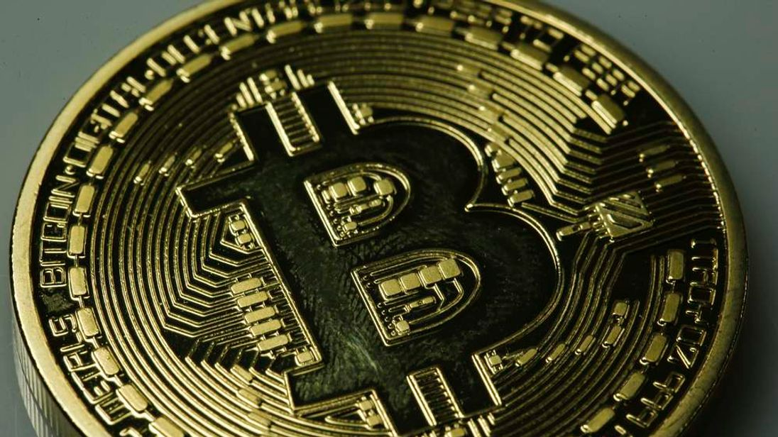 A mock Bitcoin is displayed on a table in an illustration picture taken in Berlin