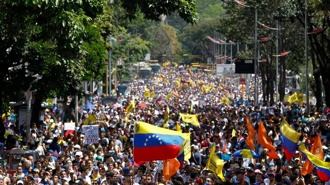 Opposition demonstrators take part in a protest against Venezuela's President Nicolas Maduro's government in Caracas
