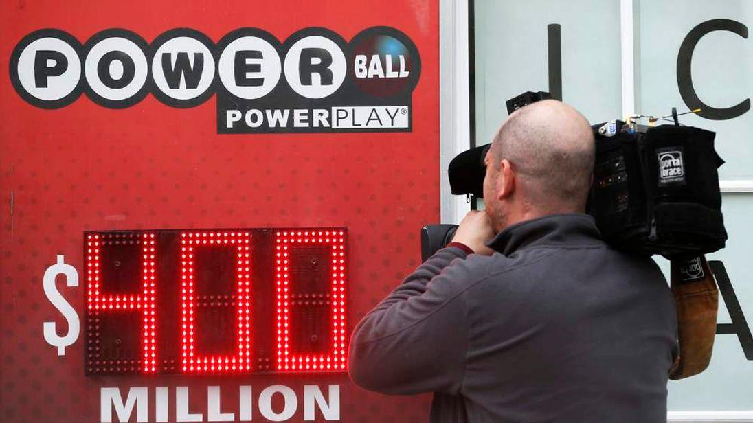 A cameraman films a Powerball sign in Virginia