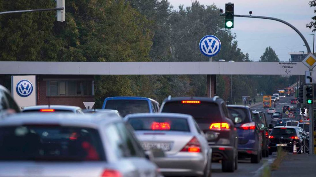 "Cars drive through the ""Sandkamp Gate"" to the Volkswagen factory in Wolfsburg"