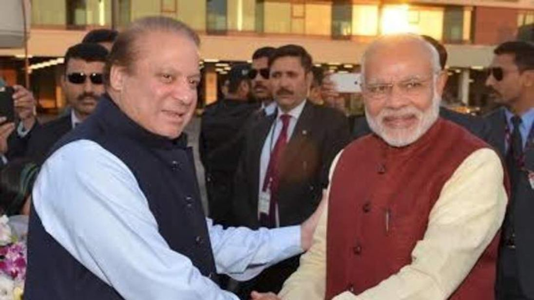 Pakistani Prime Minister Nawaz Sharif shakes hands with his Indian counterpart Narendra Modi after his arrival in Lahore