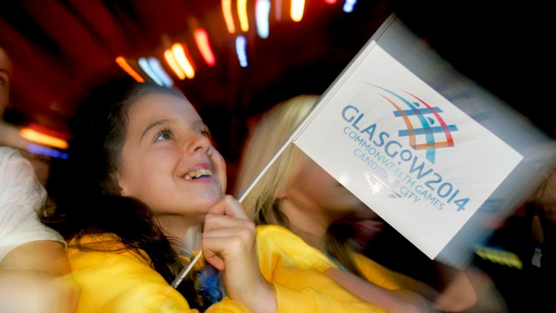 A young supporter of the Glasgow 2014 Commonwealth Games bid reacts after it was announced the city would hold the games in Glasgow