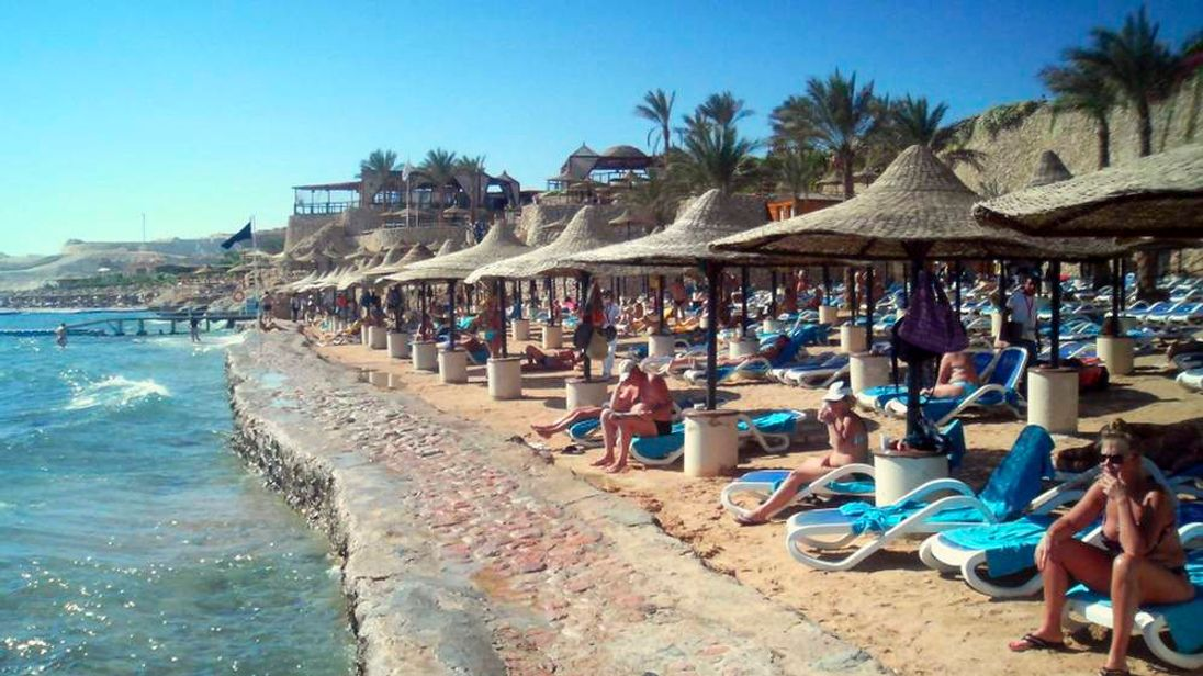 Tourists are seen at a beach with a swimming ban at the Red Sea resort of Sharm el-Sheikh