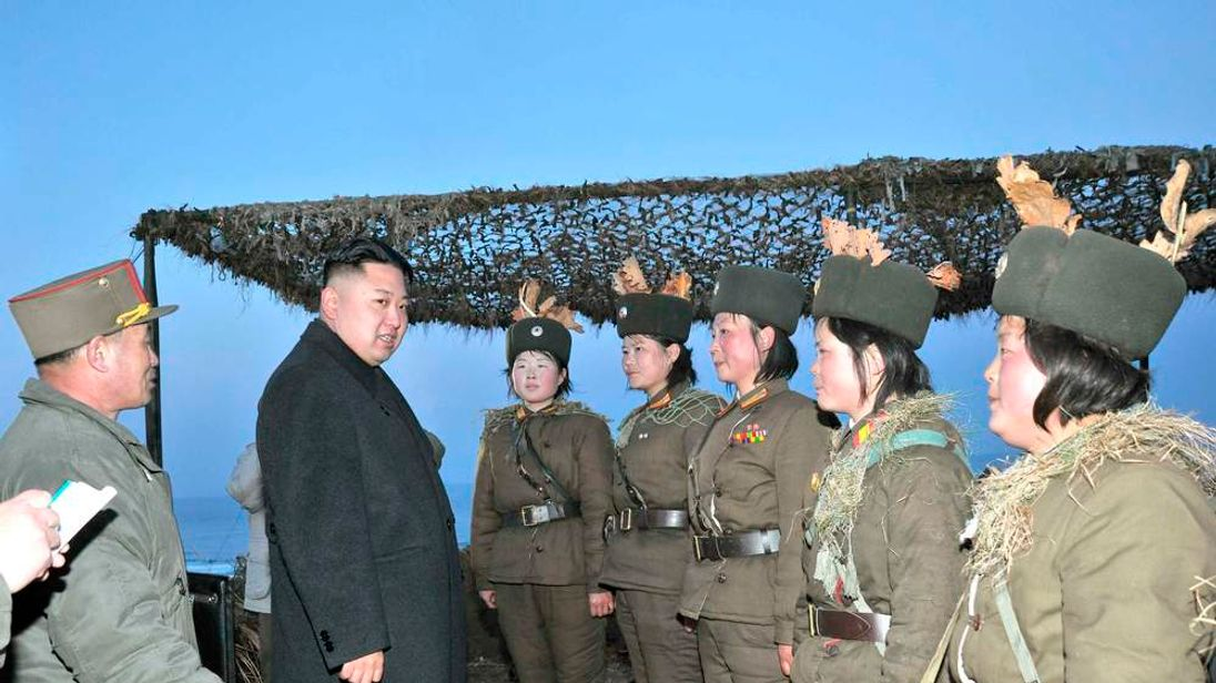 North Korean leader Kim Jong-Un talks with soldiers of the Korean People's Army (KPA) taking part in landing and anti-landing drills in the eastern sector of the front and the east coastal area