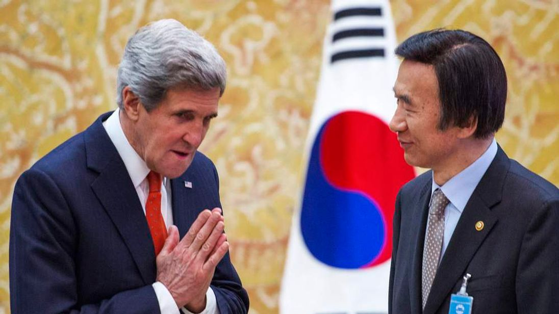 U.S. Secretary of State Kerry gestures to South Korea's Foreign Minister Yun shortly before arrival of South Korean's President Park in Seoul