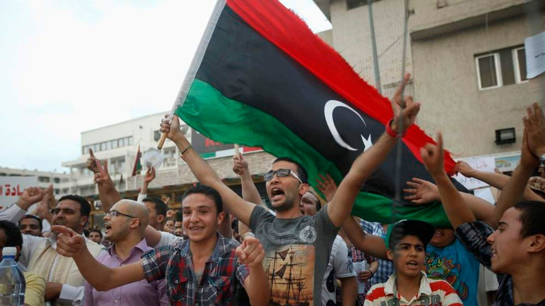 Pro-government protesters rally against gunmen who have taken control of two ministries in the capital, in front of the Libyan Prime Minister's residence, in Tripoli