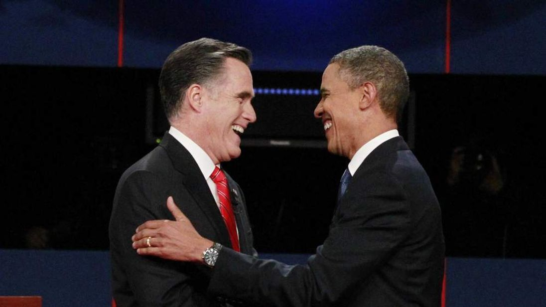 Republican presidential nominee Mitt Romney (L) shakes hands with President Barack Obama