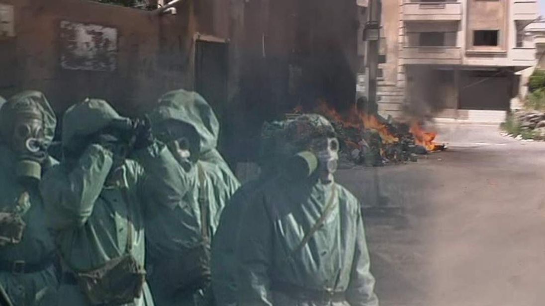 soldiers in chemical weapons gear