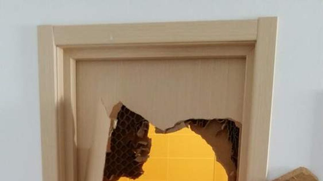 US bobsledder Johnny Quinn smashes a huge hole to break out of bathroom