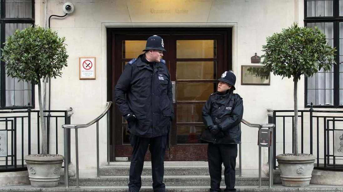 Pc Anthony Wallyn and his colleague stand guard  outside King Edward VII's Hospital