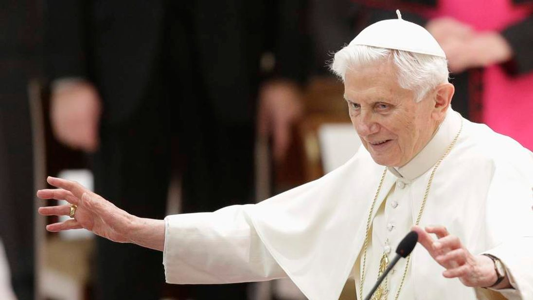 Pope Benedict XVI gestures as he arrives to lead a special audience with priests of the Diocese of Rome in Paul VI's hall at the Vatican