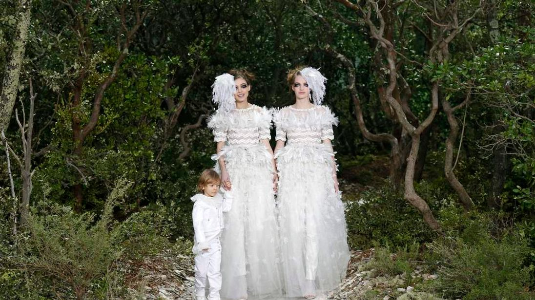Models present creations by German designer Karl Lagerfeld for French fashion house Chanel as part of his Haute Couture Spring-Summer 2013 fashion show in Paris.